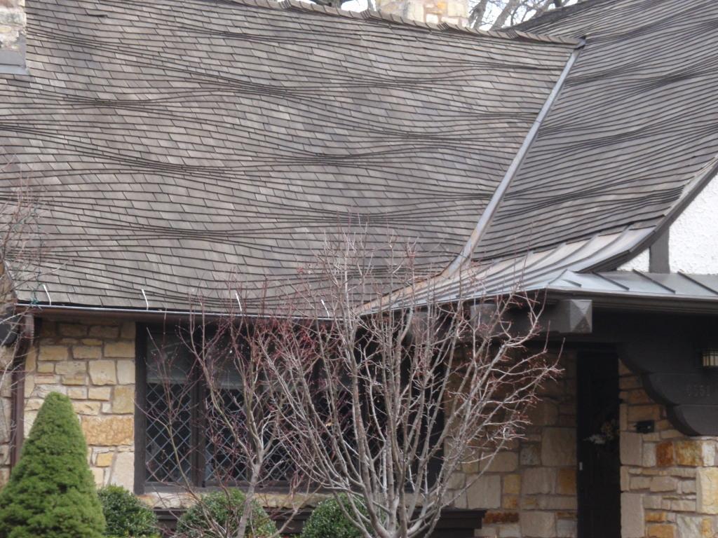 Undulating roof by Harold Zook at 6551 N Waukesha