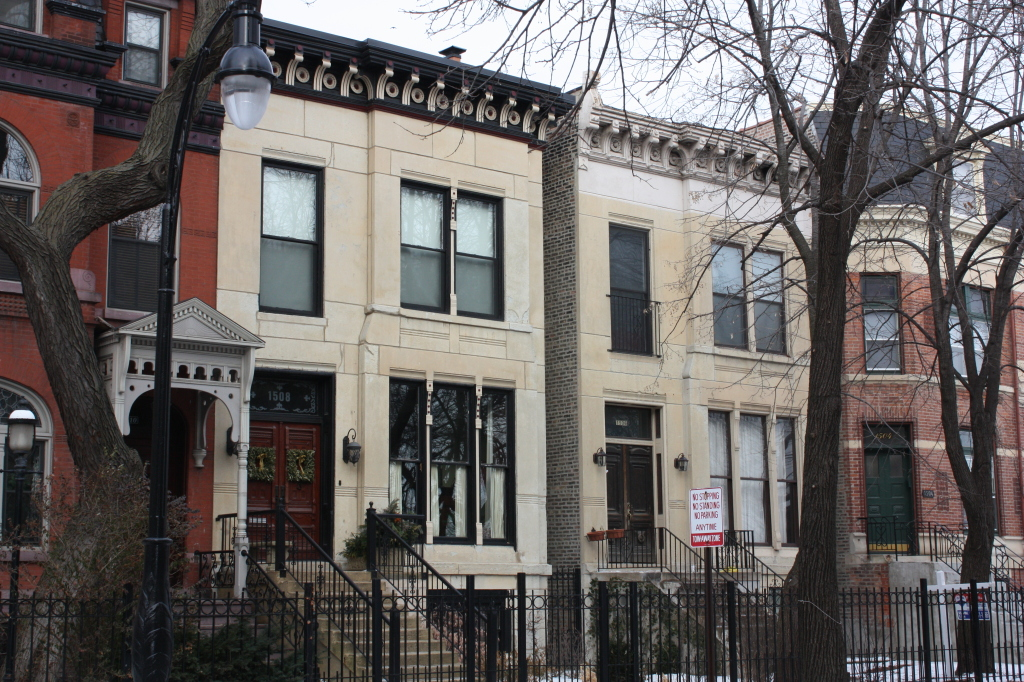 In 1884 Edward Baumann designed this double-house at 1506 and 1508 W Jackson for himself in Marble front Italianate style.